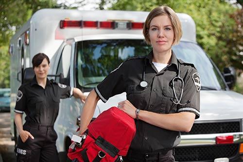 two emts outside ambulance